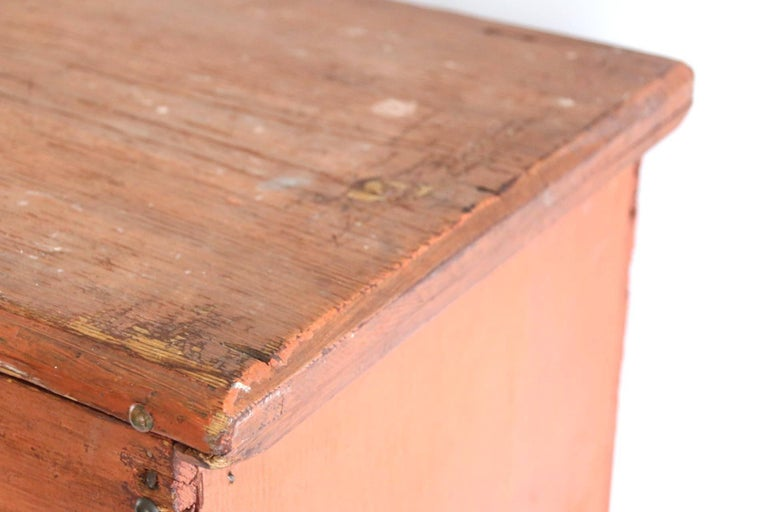 Late 18th century-early 19th century New England child's blanket chest, the rectangular lid with molded edges above the conforming case opening to an interior fitted with till. Sides continue to shaped boot jack ends. Square nails used in