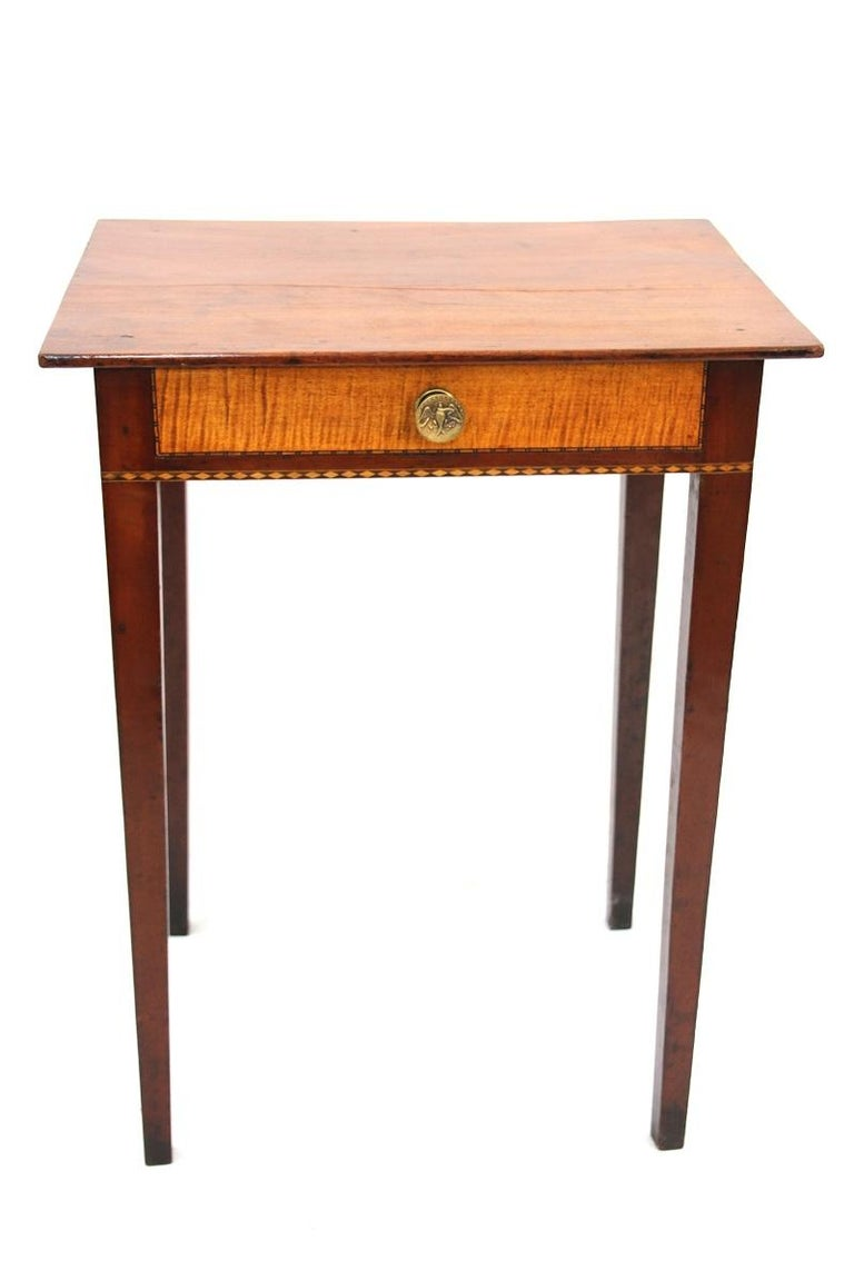 Period Hepplewhite cherry one drawer stand with tiger maple drawer front and banded inlay. Original pull featuring an patriotic eagle.  Connecticut, circa 1800.  Measures: 27