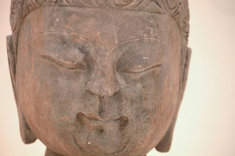 A large 20th century Chinese carved blue stone Buddha head from the Fu Jian Province, circa 1980s.