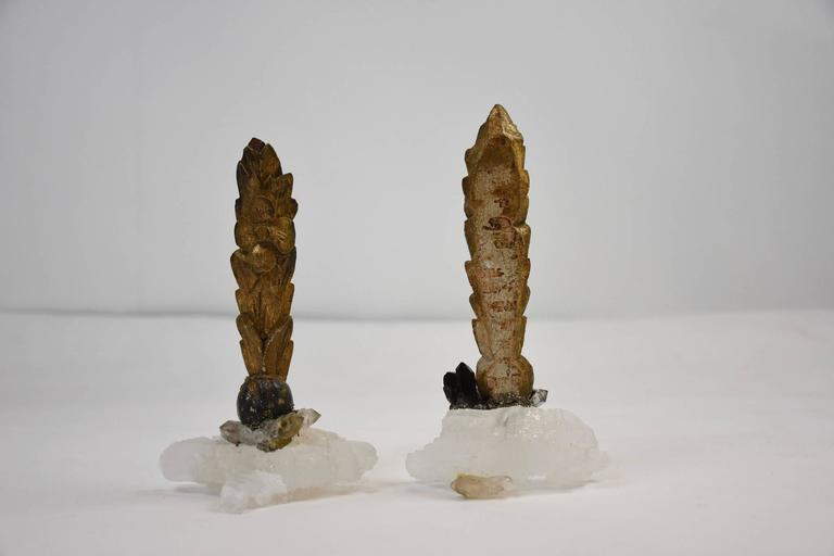 Italian giltwood fragments affixed to natural calcite or quartz crystal base. These are beautiful antique artifacts that have been taken away from their original context and changed into organic works of art.