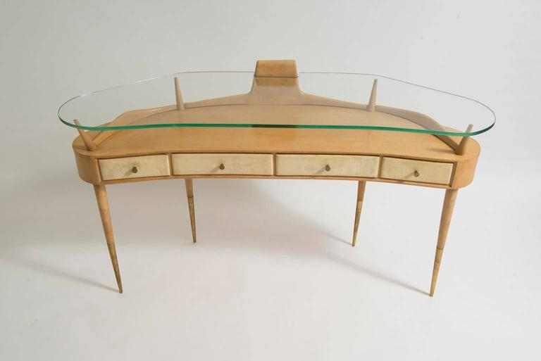 Chic, Gio Ponti attributed mid-century modern birch and maple vanity table or console table with glass top, four drawers, brass feet and hardware, circa 1950.