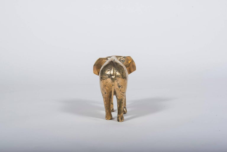 A vintage solid brass elephant ready for any table or bookshelf.