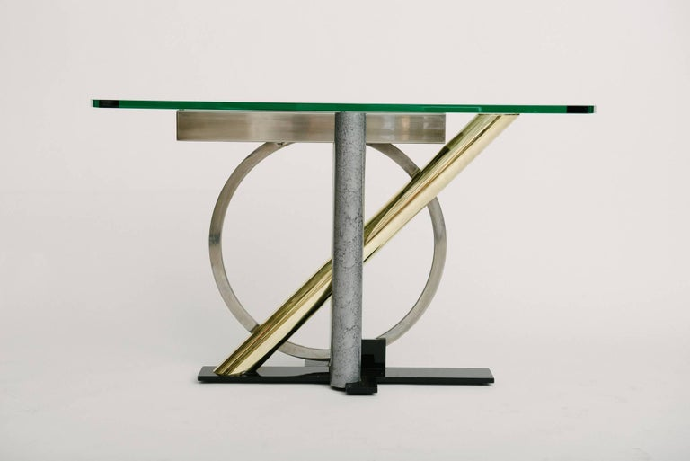 Vintage geometric mixed metal console table with glass top by Kaizo Oto for Design Institute America.