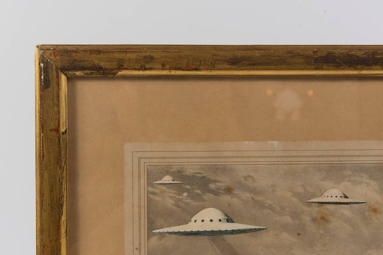 La Cinquantaine UFO Invasion. This is an original contemporary work of art in which a local anonymous artist has hand-altered a found early 19th Century French engraving of a 50th anniversary celebration in a giltwood frame.