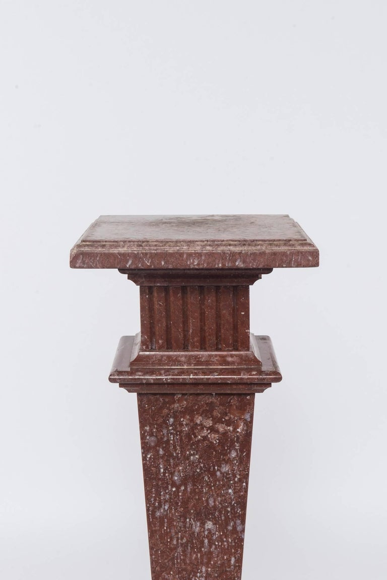 An early 20th century neoclassical style red/rouge marble pedestal.