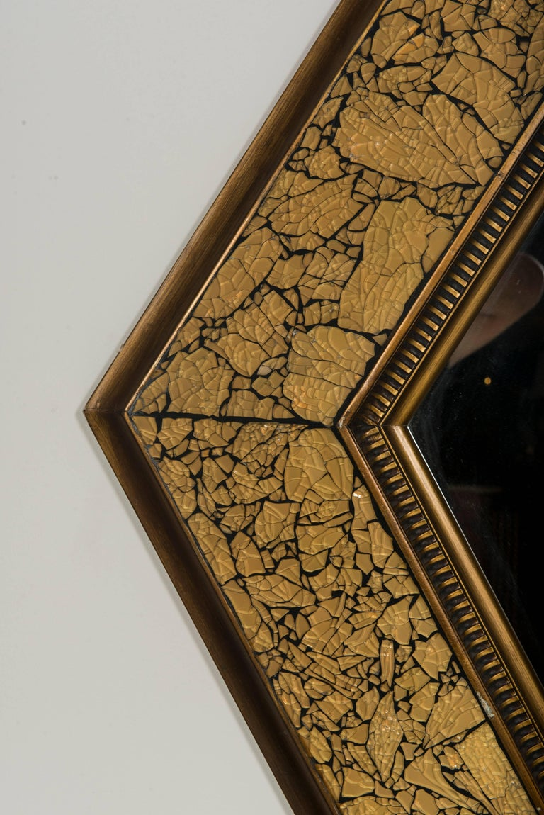 A midcentury diamond shaped giltwood mirror with mosaic glass.