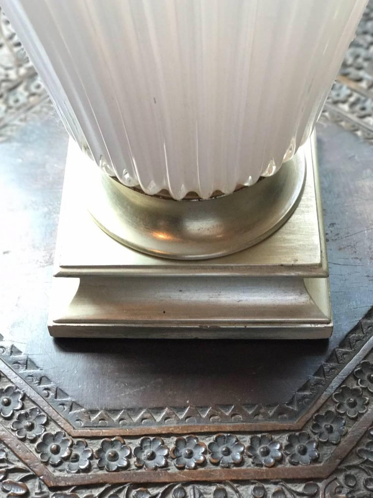 A vintage Murano pale pink white opaline glass lamp with silver giltwood base and white paper shade.  Dimensions: Silver giltwood bases 7