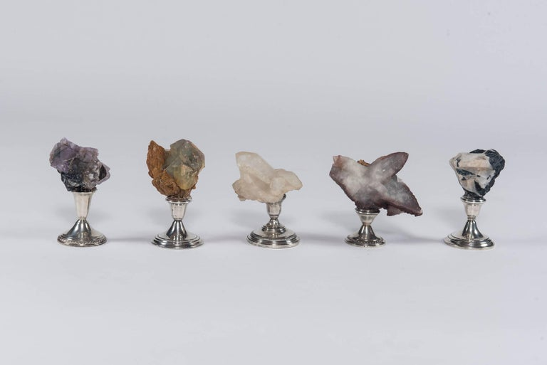 A handsome display of earth's most breathtaking examples of natural history that have formed over the past 450 million years. Five natural mineral specimens collected from around the world are mounted on vintage sterling bases. A wonderful set to