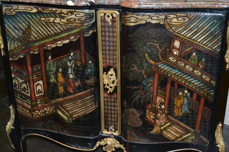 Stunning 19th century French Belle Époque Coromandel two-door lacquered server. Having vibrant courtyard scene across shaped door fronts, Fine gilt bronze mounts, and Breche Nouvelle marble top. Wonderful for numerous designs!