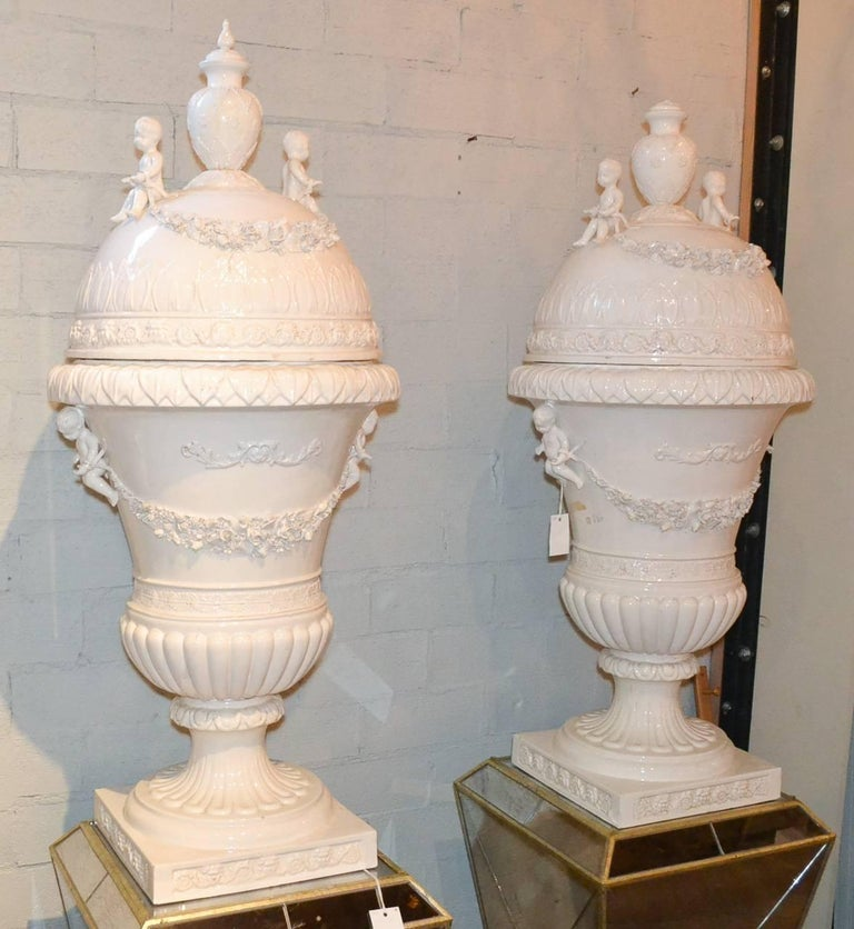 Early 20th Century Great Pair of Italian Glazed Porcelain Capped Urns For Sale