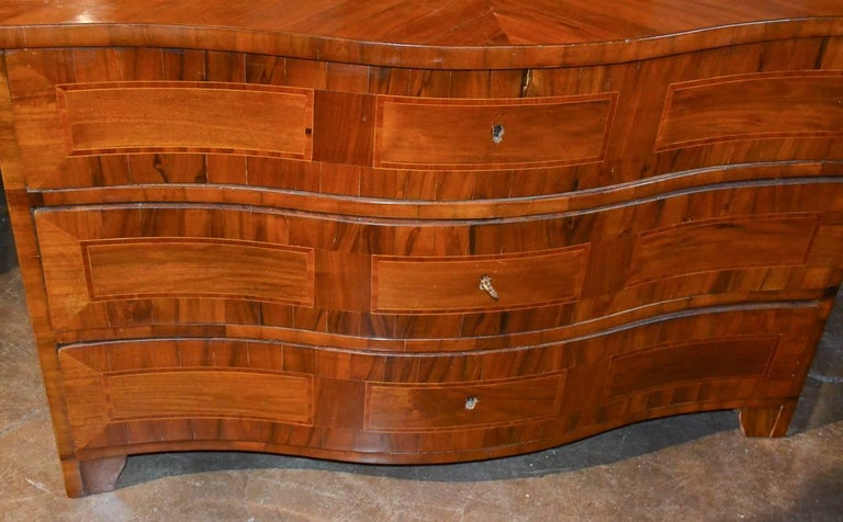 Sensational 18th century German shaped front 3-drawer commode.  Having stylish and refined geometric inlays, a rich warm patina, and featuring clean lines that work with many types of decor!
