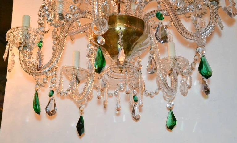 Lovely English glass and crystal 10-light chandelier.  Having gracefully curved arms, accented with vibrant green prisms, and top with spiraling adornments.  Perfect for today's stylish decors!