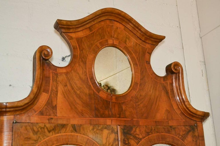 Sensational antique Italian burl walnut three-drawer secretary. Having lovely mirrored pediment, shaped drawer fronts, fitted interior, and gorgeous warm patina. A fantastic piece to suit many types of decor!