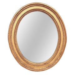 French Carved Giltwood Oval Wall Mirror, circa 1910