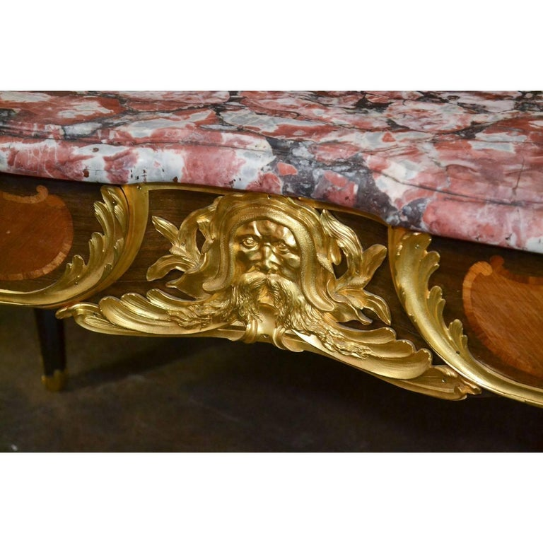 Extraordinary and important 19th century French Louis XV style writing desk by the renowned master craftsman L. Cueunieres Ebeniste.  The shaped top with a remarkable mosaic marble above a kingwood base mounted with highly detailed doré bronze