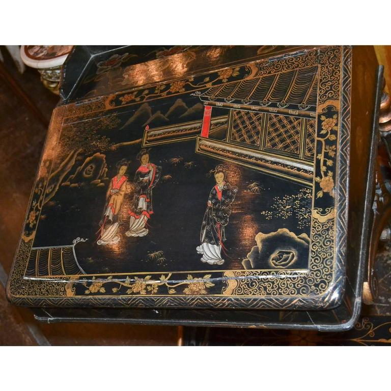 Interesting legs on this stunning English black lacquered chinoiserie Davenport desk. A Davenport desk is a small desk that has a hinged lifting desktop, circa 1880.