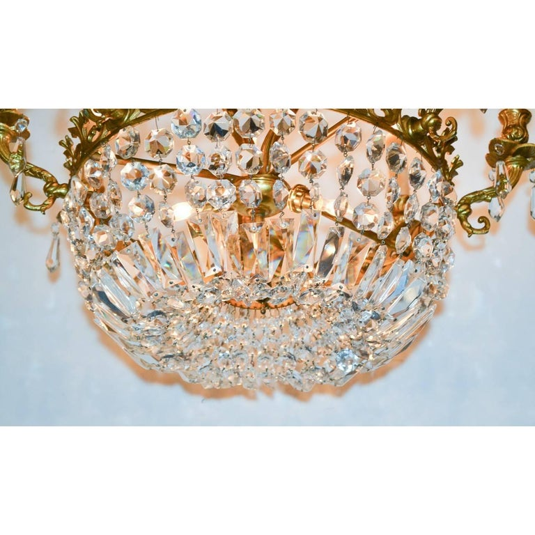 Stunning French bronze chandelier with basket of beautiful cascading crystals, circa 1920.
