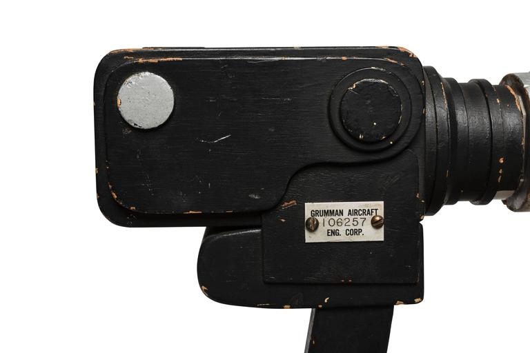 This wooden mock-up of the storied Hasselblad 500 camera with telescopic lens was produced by the Grumman Aircraft Engineering Corporation as a practice tool or prototype for the real camera. The actual Hasselblad 500, on which this mock-up is