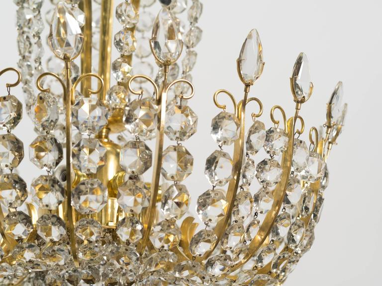 Fully restored and rewired, elegant crystal and brass Lobmeyr chandeliers from the 1950s. Sold as a pair or individually.