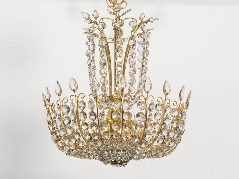 Czech Pair of Elegant Crystal and Brass Chandeliers By Lobmeyr For Sale