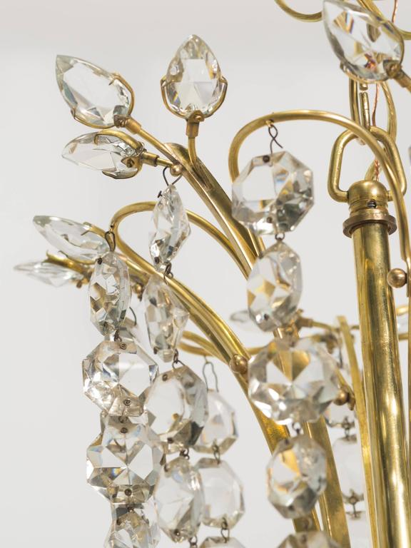 Mid-20th Century Pair of Elegant Crystal and Brass Chandeliers By Lobmeyr For Sale