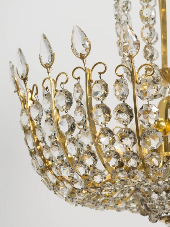Pair of Elegant Crystal and Brass Chandeliers By Lobmeyr For Sale 1