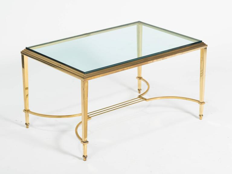 Chic Regency style thick glass cocktail table.