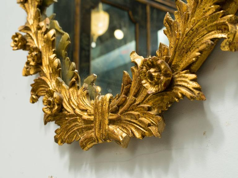 Highly carved Italian giltwood mirror. There is a second one of these mirrors available, reference number LU 1078217049281, .since the're hand carved it's slightly different.  A few pieces missing.