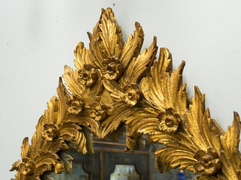 1960s Italian Carved Wood Floral Gilt Mirror. Pair available. In Good Condition For Sale In Tarrytown, NY