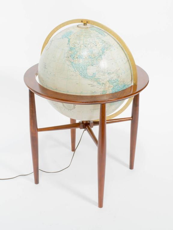 Refinished Replogle illuminated globe on stand.