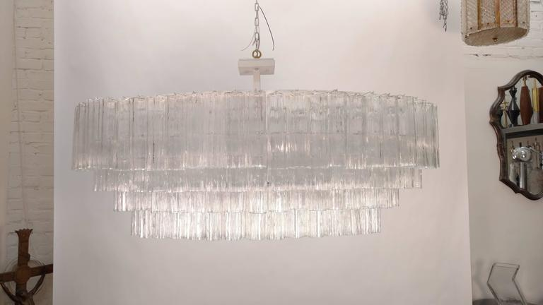Large Venini glass chandelier composed of approximately 200 tronchi glass. Rewired with 26 new candelabra sockets. Max. 40 watt per socket.