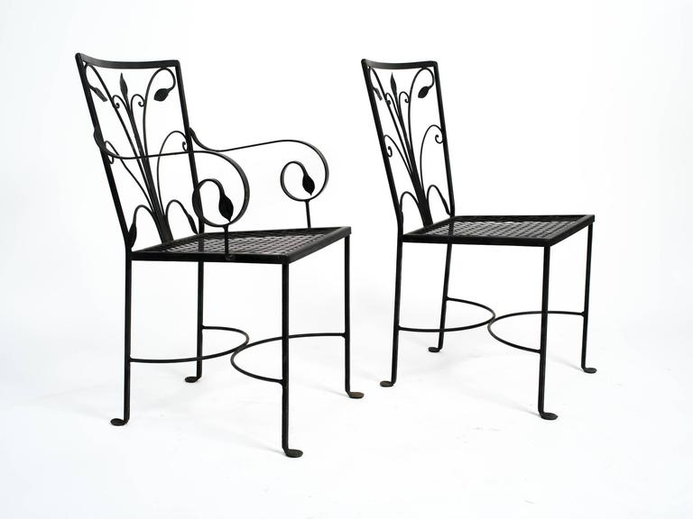 1950s wrought iron outdoor set with six dining chairs and