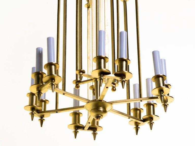Twelve-light brass Skyscraper chandelier.