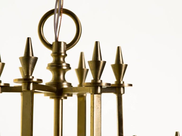 Twelve-Light Brass Skyscraper Chandelier For Sale 2