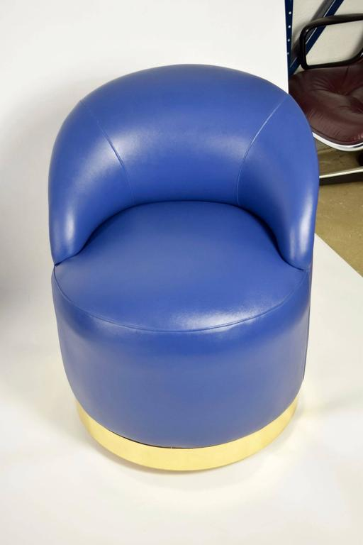 Karl Springer Style Chairs in Blue Leather with Brass Finish Base on Casters For Sale at 1stdibs