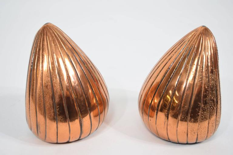 Heavy bookends by Ben Seibel in a copper finish.