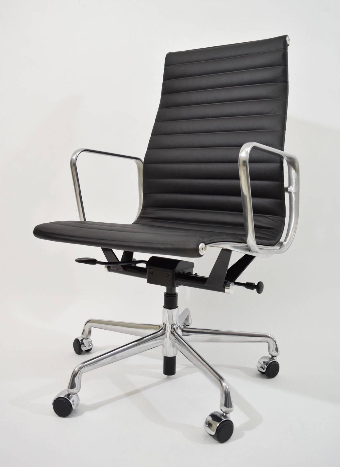 three left eames aluminum group executive chairs at 1stdibs