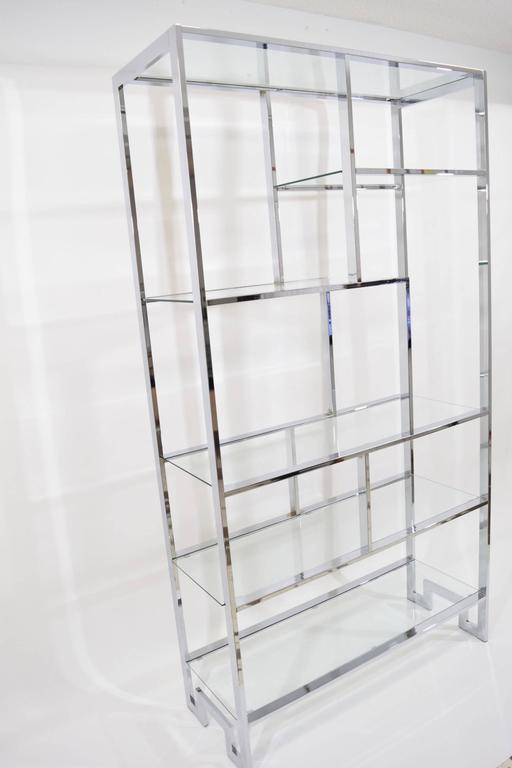 A chrome and glass etagere by Milo Baughman. We also have a pair available.