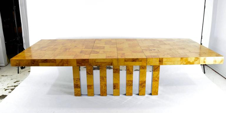 "This is a beautiful table by Paul Evans for Directional. Beautiful patina burl wood in a mosaic pattern. Chrome trim on base. Table has two leaves that are 15""long which extend overall table length to 114"". Reference Paul Evans, Designer"