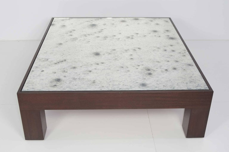 Custom coffee table with large wood base done in an espresso finish and an antiqued mirror top. Very beautiful and great quality.