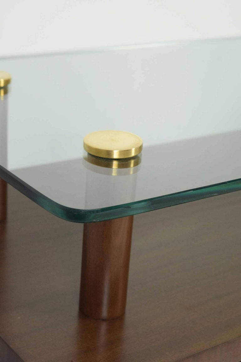 Restored nightstands with glass tops and single door compartment. Brass detail. Gilbert Rohde for Herman Miller.