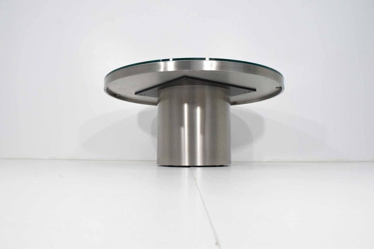 This is very much of the quality of Brueton. Polished stainless steel base with glass top. In beautiful condition.