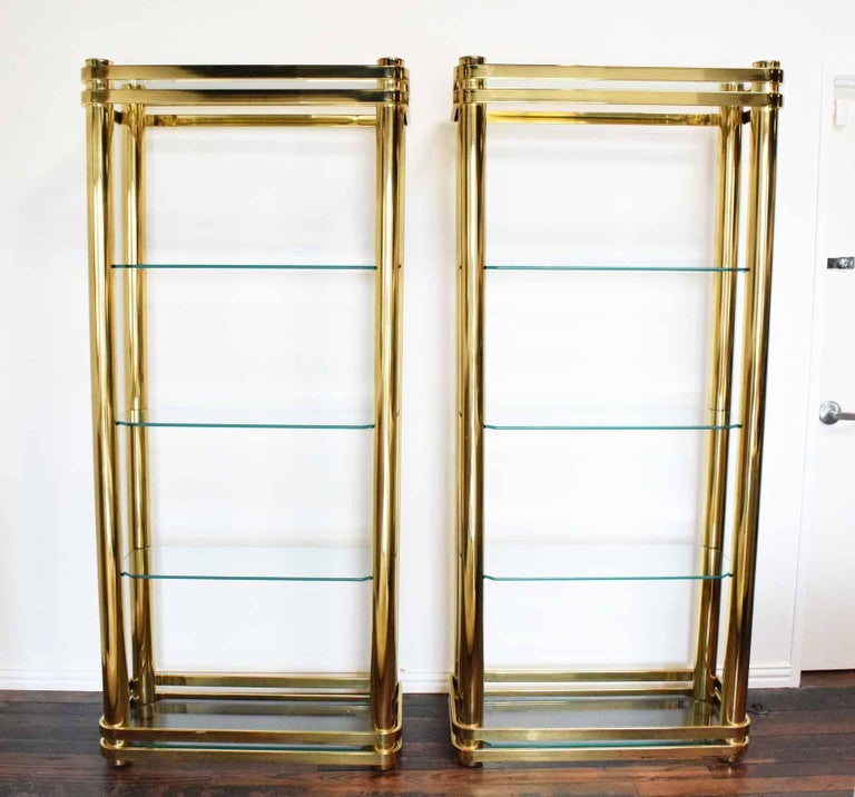 Beautiful pair of brass finish etageres, glass shelves. Heavy construction, very well made. Glass shelves are 1/2