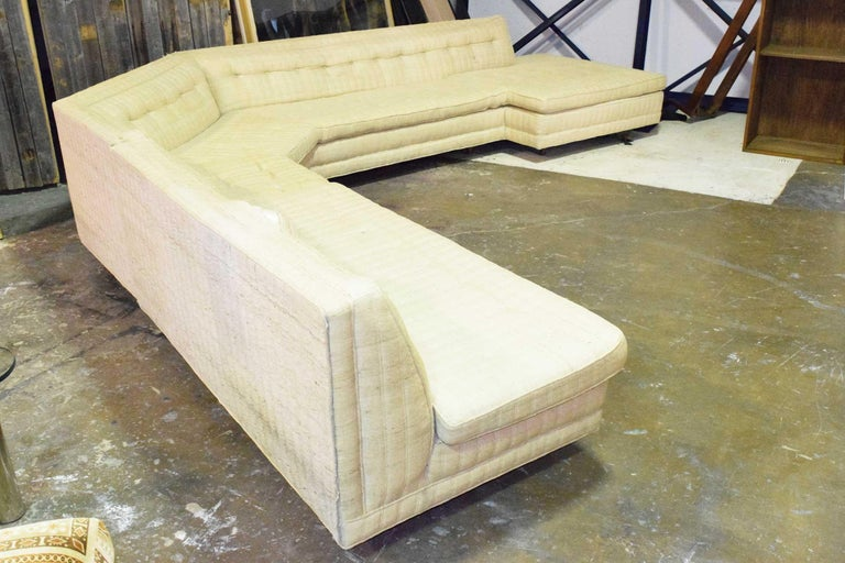 With an imagination, this sofa would be stunning once restored. It is a hard to find large sectional by Harvey Probber. Very sophisticated, will make a statement in any room. Inviting for large groups with plenty of seating. We can offer full
