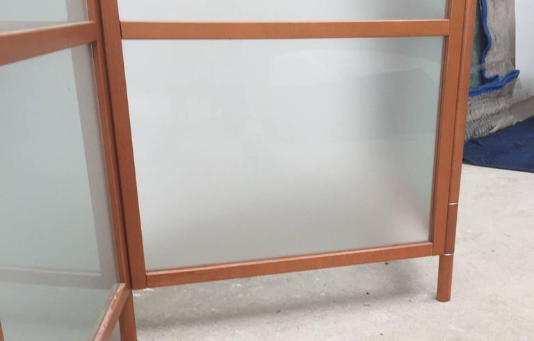 Beautifully constructed, this screen has the appearance of a handcrafted studio piece. It has a hinging devise that is artistically crafted to conceal the joinery.  Each panel measures 25