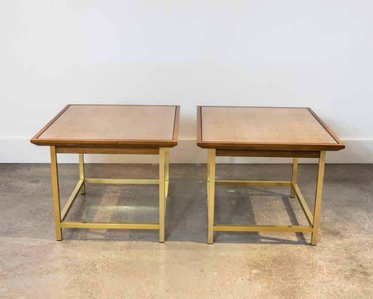 This pair of tables are architecturally perfect in as much as they incorporate glass, wood, brass and metal yet the design is understated. Perfect size end tables or use them together for a coffee table.