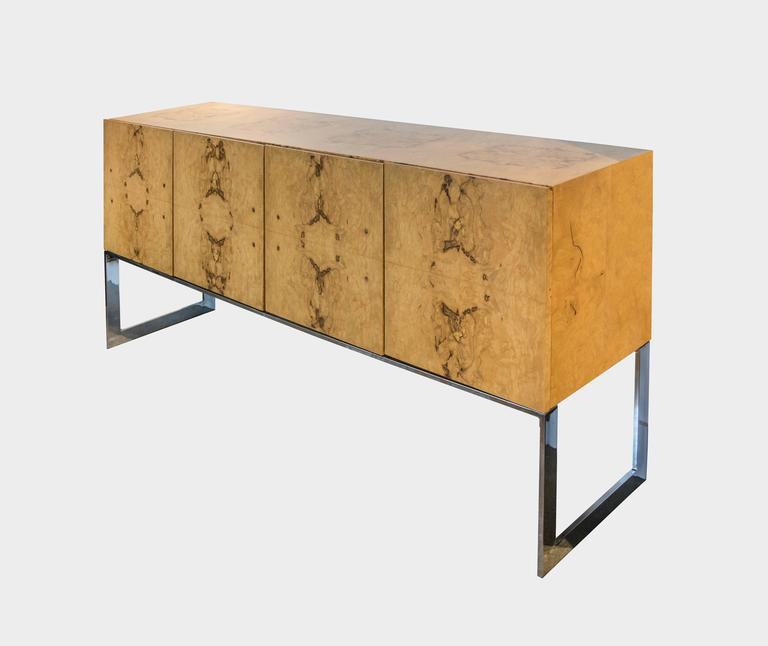 Rarely do we come across an actual Milo Baughman for Thayer Coggin gorgeous buffet or credenza. It features two silver lined drawers for cutlery and utensils on one side and on the other side there are two shelfs, one made of smoked glass and the
