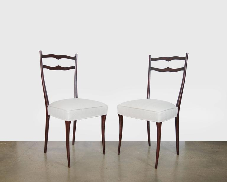 A graceful set of six dining chairs from Italy, made in the 1950s and thought to be designed by Ico Parisi. The chairs are mahogany; the seats are newly upholstered in Knoll Djenge fabric, colorway salt.
