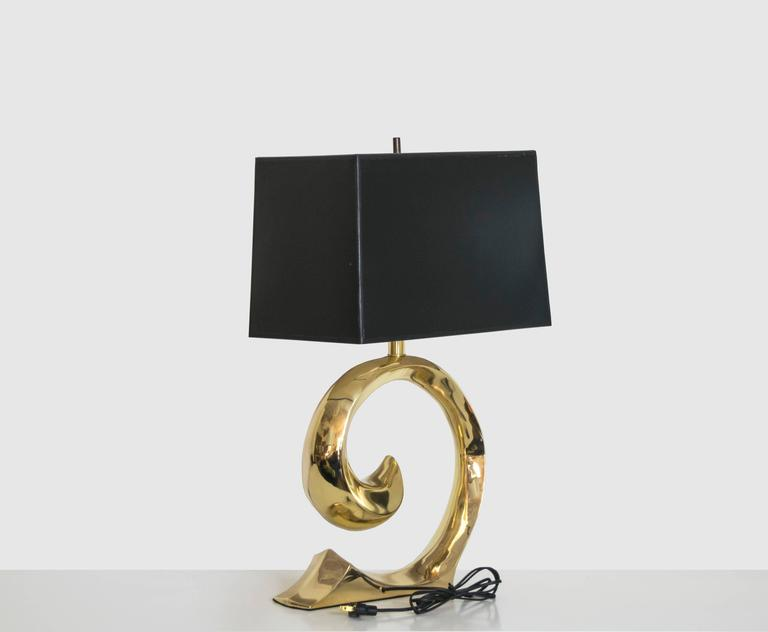 Exquisite pair of very solid and well-constructed brass lamps with the Pierre Cardin signature curve. These lamps have been recently polished and are in pristine condition. Would look great in any interior, whether traditional or contemporary.