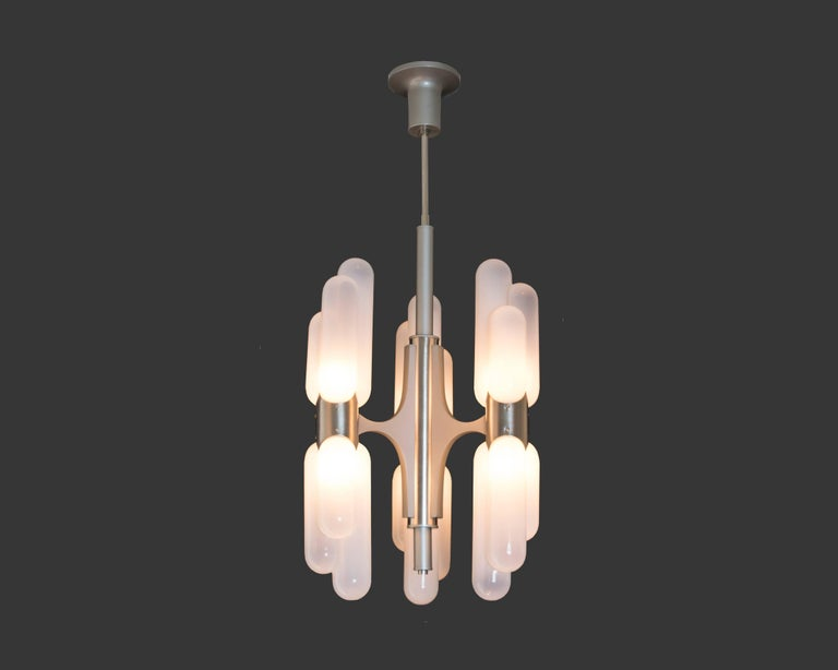 Exquisite handblown Murano glass chandelier by Italian Mid-Century master Carlo Nason for Mazzega lighting. Six torpedo shaped lights up and down; it has recently been rewired to US standards. We have three pairs of sconces and a larger coordinating